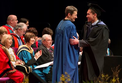 The Vice-Chancellor congratulating a student at graduation