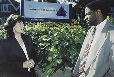 Two people standing outside the Leaf Hospital, 1994