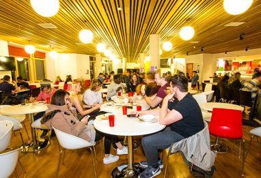 Students eating at the Hub