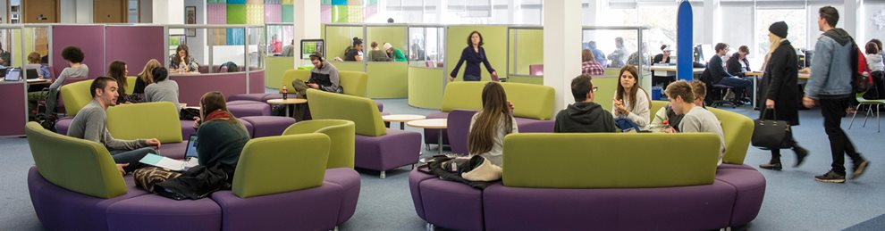 Student lounge in Cockcroft building with students working.