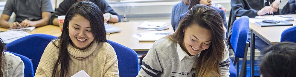 Smiling Business Management students in lecture