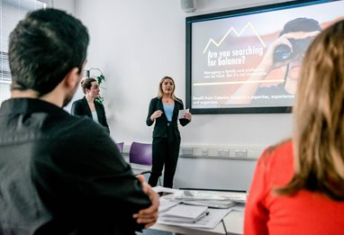 Woman in a suit giving a business presentation