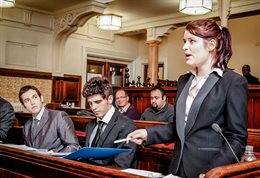 Students having a debate in a courtroom