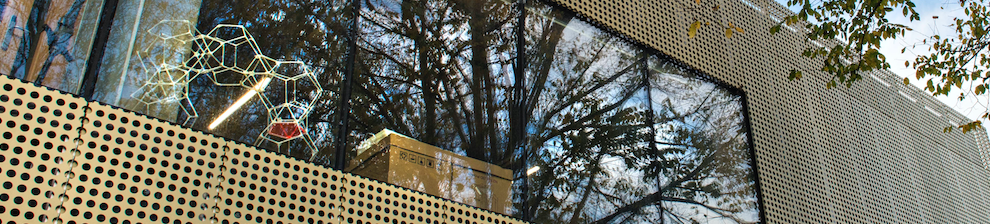 Angle of gold perforated building facade of Advanced Engineering Centre at the University of Brighton
