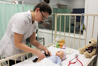 Apprentice Nurse caring for baby doll