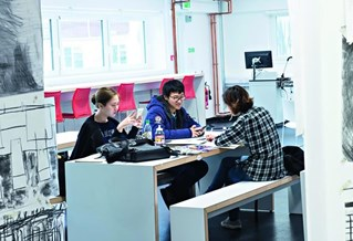Students working around a desk