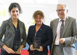 Aryako Rahimi and Alba Lewis Momentum Brighton Partnership of the Year 2016-17 receiving their awards from Professor Chris Pole
