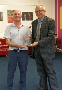Jeremy Lineham Momentum Eastbourne Mentee of the Year 2016-17 receiving his award from Professor Chris Pole