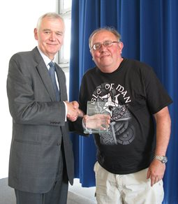 Momentum Hastings Mentor of the Year 2016-17 Graham Bean, receiving his award from Hastings Campus Director, Paul Frost