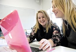 Two students with pink laptop