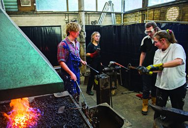 University students using a working forge