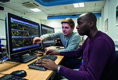 Students in University of Brighton real-time Trading Room