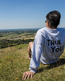 'Be true' student looking at sussex downs