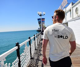 Student walking on Brighton Palace Pier
