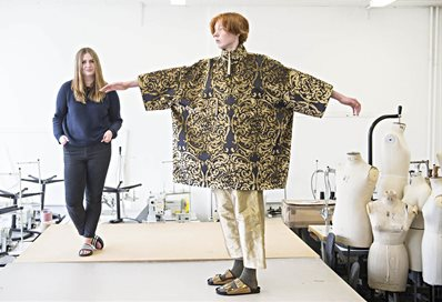 Fashion student with a model wearing her designs
