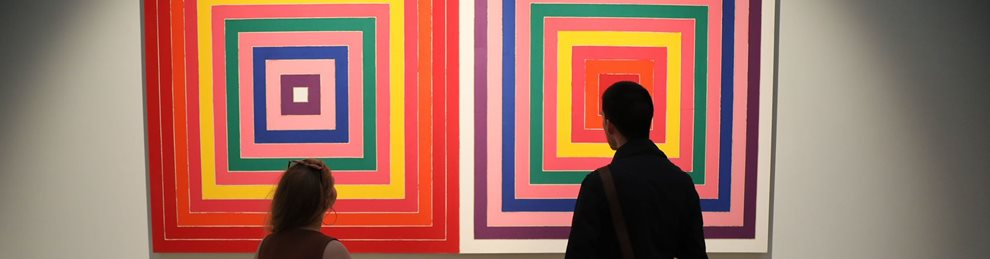 Two people looking at images of coloured squares