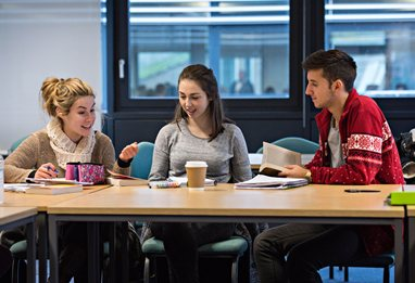 Students discussing work in a seminar