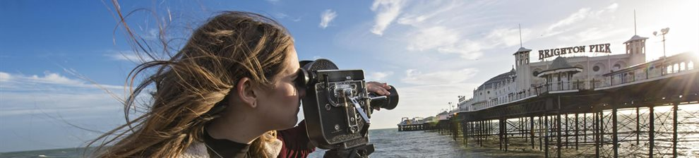 Student filming the pier
