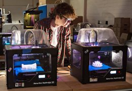 Student with 3D printers