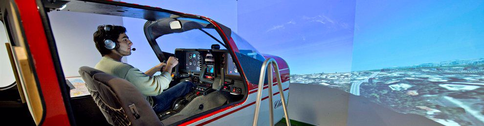 A student having a simulated flying lesson in a real plane cockpit