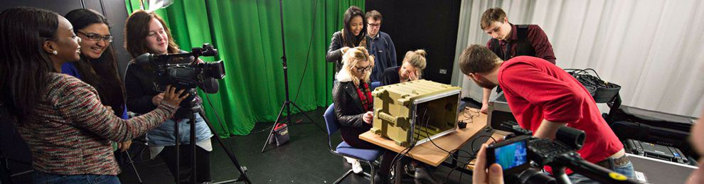 Broadcasting students in the film studio, behind cameras, presenting and directing