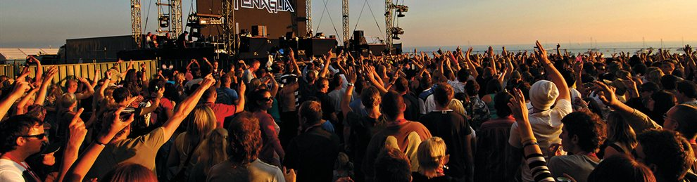 Crowds of people on Brighton beach at a Fatboy Slim concert