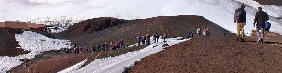 Students walking over snowy hills on field trip abroad.