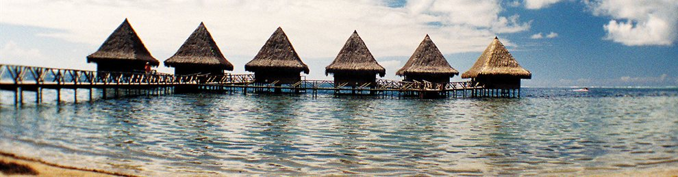 Hotel rooms made of local thatch on a South Pacific beach