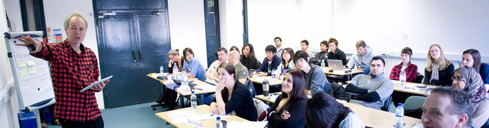 A business seminar with a lecturer and attentive students