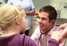 A doctor smiling at a child