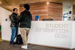 Students at the Student Information Desk, Falmer