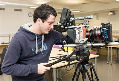 Student operating a film camera