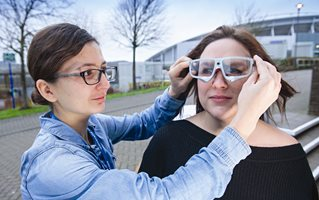 Two students testing a pair of smart spectacles
