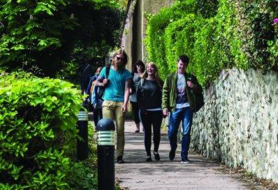 Students walking down leafy path in Eastbourne