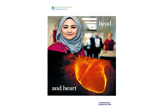 A student and a human heart with the words: Head and Heart