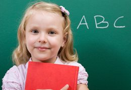 Child in front of blackboard