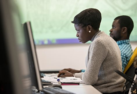 Two BAME students using computers
