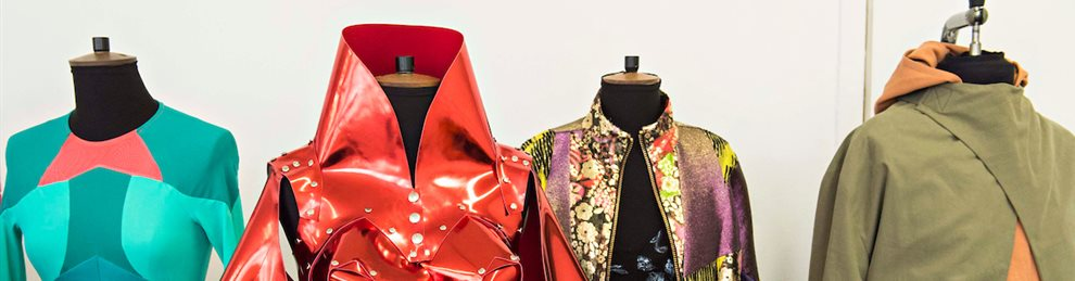 A collection of stylish jackets on display stands.