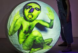 Green man projected onto a sphere