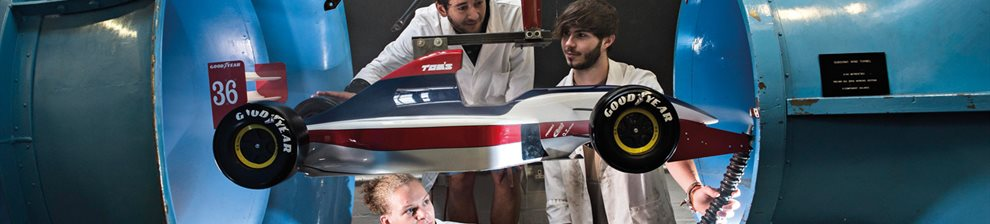 Engineering students testing aerodynamics in the workshop