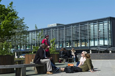 Students sitting outside at the Falmer campus