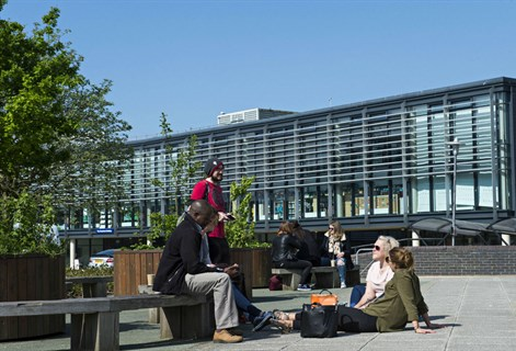 Students enjoy the sunshine on the Falmer campus
