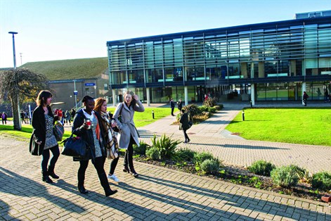 group of students walking through Falmer campus