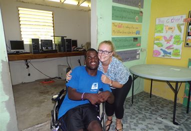 Placement student Hayleigh Ponting embracing a man in a wheelchair