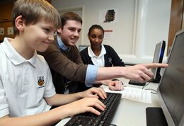 School pupils at computer screens