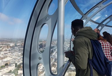 People looking at the view from within the i360
