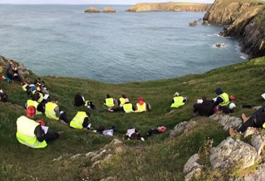 Students by lake on field trip to Pembrokeshire