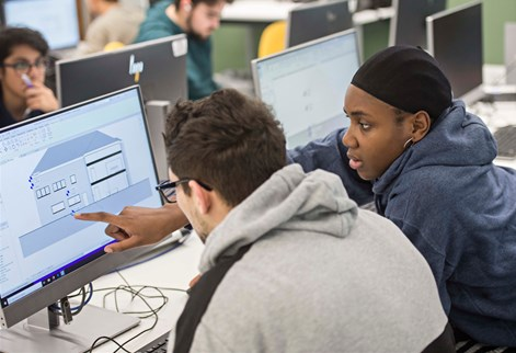 Students studying architectural diagrams on the computer