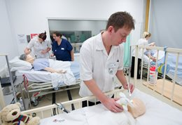 Nursing students in a clinical skills suite