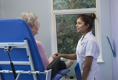 Student with patient at Leaf Hospital, Eastbourne